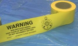 Air bag warning barrier tape